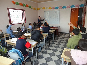 Working and dropped out of school children attending a mathematics class at Tdh child protection centre. © Photo by Terre des hommes