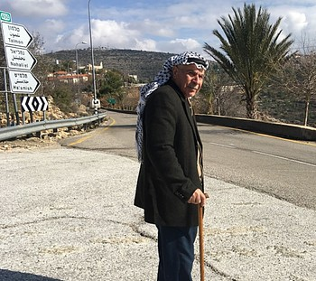 Abbas Yousif standing on access restricted road leading to Talmon, Dec 2016. © Photo by OCHA