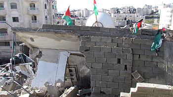 A four-story building blown up on punitive grounds in Al Am'ari refugee camp (Ramallah) on 15 December. Photo by OCHA