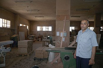 Mujahed al Sousy in his furniture  workshop, June 2017. ©  Photo by OCHA.