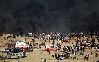 Black smoke rising from burnt tires during demonstrations at the fence, Gaza. ©  Photo by WHO