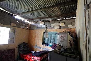 Damaged house of Kishko's family, Gaza city, March 2018. ©  Photo by OCHA