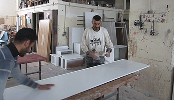 Workers in the Sousy Furniture Company. Photo by WFP/ElBaba