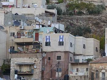 Suhaib's house in Silwan, East Jerusalem, next to an Israeli settlement. ©  Photo by OCHA.