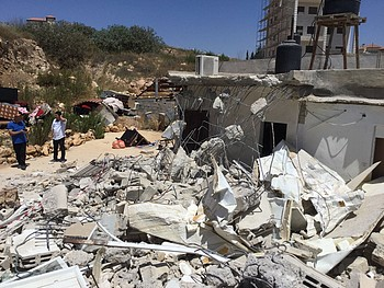 Demolition of an extension of a house in Beit Hanina, East Jerusalem, on 26 June. Photo by OCHA.