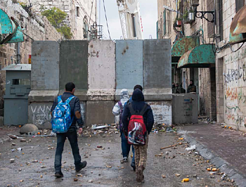 Main route into the Israeli-controlled area of Hebron City (H2), January 2016. Photo by UNICEF