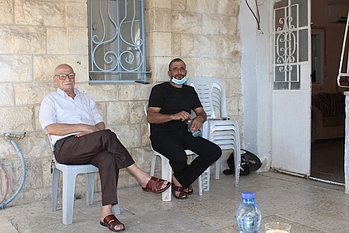 Mr. Salah with one of his sons, 13 October 2020. Photo by OCHA.