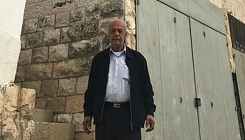 Mr. Sabbagh standing in front of the family house. December 2018. © Photo by OCHA