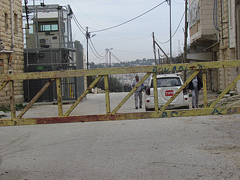 Temporary International Presence in Hebron (TIPH) at Israeli manned checkpoint (H2) Hebron. February 2018. © Photo by OCHA