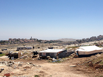 Jabal Al Baba (Jerusalem), a Bedouin community at risk of forcible transfer. In the background Ma'ale Adummim settlement. Photo by OCHA