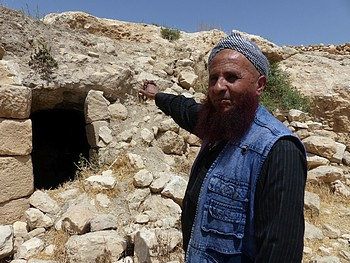 Khaled al 'Amoor outside his destroyed cave in Sarura, May 2017. ©  Photo by OCHA.