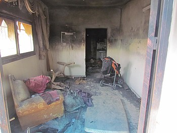 Palestinian home in Duma village (Nablus) set on fire by an Israeli settler, August 2015. © Photo by OCHA