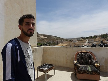 Mohammed al Ammasi at the lower rooftop of his house in al Fawwar, May 2017. ©  Photo by OCHA.
