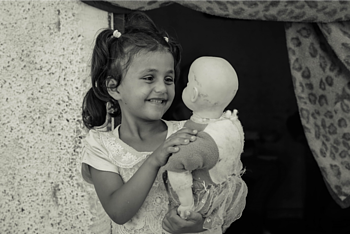 Rimas, 7, plays with her doll, at home in Jabalia on 21 August 2019. ©  Photo by Ahmed Mashharawi, NRC