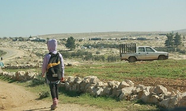 A student facing the Palestinian village of Susiya while walking home from school. Photo by Nanor Arakelian © World Vision 2018.