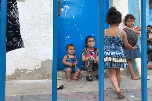 An internally displaced Palestinian family staying in and UNRWA-run school in Gaza, 14 April 2021. Photo by OCHA