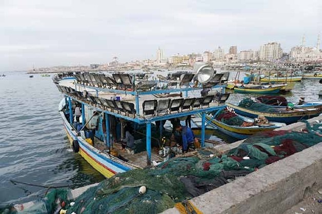 Fishing boat equipped with a lightening system to attract fish. Gaza city's port, March 2018 ©  Photo by OCHA