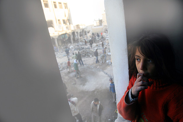 Girl looking at destruction site after Gaza 2008-2009 conflict, February 2009. © Photo by UNICEF