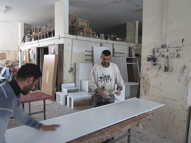 Workers in the Sousy Furniture Company, March 2015. ©  Photo by WFP/ElBaba.