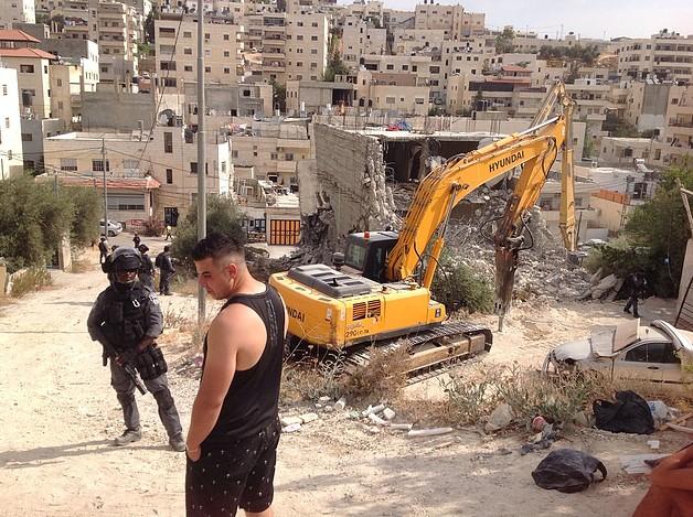 Demolition of a four-storey building in Al-'Isawiya in East Jerusalem. 11 July 2017. © Photo by OCHA