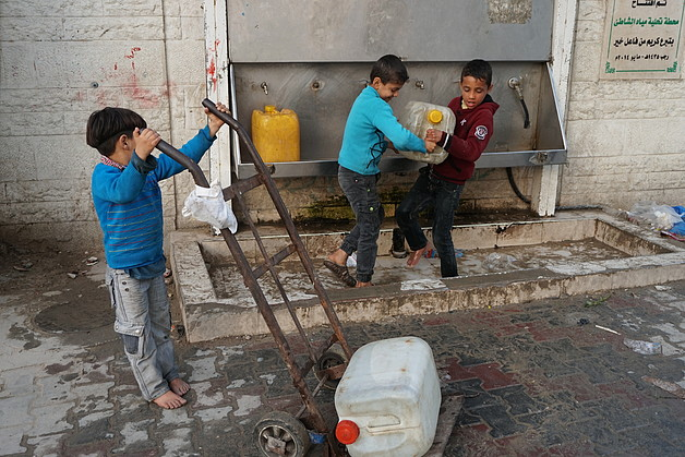 Children collecting water from a desalination point in Ash Shati Refugee Camp, Gaza, February 2017. © Photo by OCHA