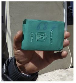 Hand-written number on ID cover of a Tel Rumeida resident, Hebron, March 2017.  ©  Photo by OCHA.