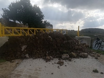 Road gate controlling access to Deir Nidham, 20 February 2020. Photo by OCHA.