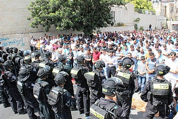 Friday prayer in a street of Wadi Al Joz (East Jerusalem) due to the age restrictions on access to the Al Aqsa Mosque, 26 September 2014. Photo by Maisa Abu Ghazaleh
