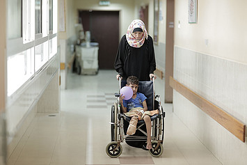 A mother and son in the orthopedic department at Ash Shifa hospital, Gaza City, October 2015