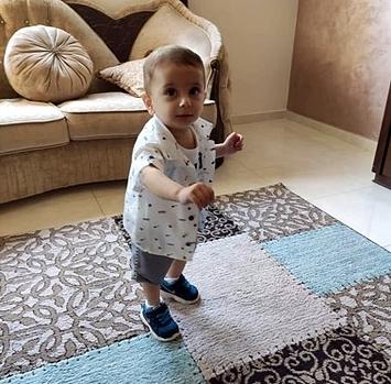 אוסאמה בן השנה אובחן כחולה לוקמיה בחודש יוני. צילום: ארגון הבריאות העולמי