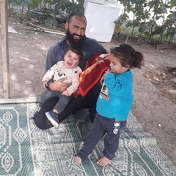 Radad Dagharme with his two toddler daughters and newborn baby, 7 December 2020. Photo by the affected family.