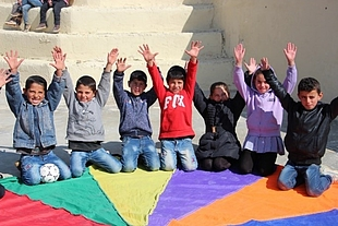 Children enjoying their time during a Psychological First Aid activity through a critical thinking game in Susiya. Photo by Jumana Rishmawi ©World Vision 2018
