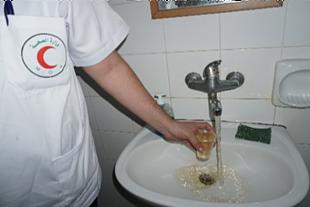 Medical staff showing rusty water available through water network, Al Shifa hospital, Gaza. November 2018