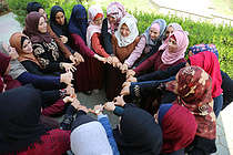 """AISHA association for Women and Child Protection group session"""". Copyright AISHA"""