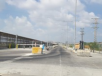 Road and pedestrian corridor leading to the terminal of the Erez Crossing, August 2019.