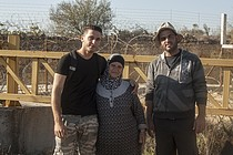 "Hiyam Ahmad Jumaa, and her two sons in front of ""Barrier Gate 105"", outside of Beit Surik village (Ramallah), 31 October, 2019. ©  Photo by OCHA"