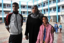 Afaf and two of her nine children at the UNRWA Collective Centre. Photo by UNRWA