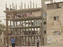 Building under construction housing IDPs; Beit Hanoun. Photo by OCHA, October 2015