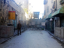 Checkpoint controlling access to the Ash Shuhada street in the heart of Hebron city. Photo by OCHA