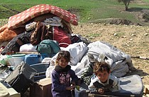 Children of a herding community with belongings after Israeli authorities demolished their structures in Ein al Hilwa (Tubas Governorate) in the Jordan Valley on 30 January 2014. Credit: OCHA