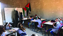 Arabic lesson in the Ras at Tin school, at risk of demolition. © Photo by OCHA