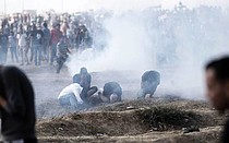Demonstrators overcome by teargas at the Gaza fence, March 2019.