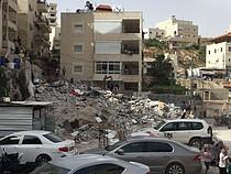Three-storey  building demolished in Al Isawiya, East Jerusalem, 1 May 2018. © Photo by OCHA