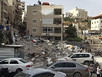 Three-storey  building demolished in Al Isawiya, East Jerusalem, 1 May 2018. © Photo by OCHA