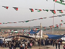 """The """"Great March of Return"""" demonstration near the perimeter fence, east of Gaza city, 13 April 2018."""