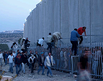 Gilo checkpoint at dawn. Palestinian workers wait behind a fence to cross into East Jerusalem to work. When the gate opens late workers desperate to get to work on time jump the queue. OCHA 2007