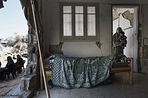 A house in the Toufah area of Gaza city severely damaged during the July-August hostilities. Photo by UNICEF/Romenzi