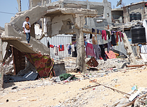 IDPs living makeshift in shelters next to their destroyed homes, Beit Hanoun. Photo by OCHA