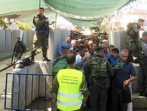 Gilo checkpoint, Palestinians accessing East Jerusalem for the Ramadan Friday prayer, 3 July. Photo by OCHA