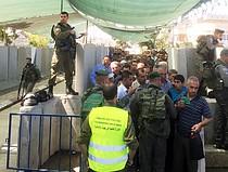 Gilo checkpoint, Palestinians accessing East Jerusalem for the Ramadan Friday prayer, 3 July. Photo by OCHA